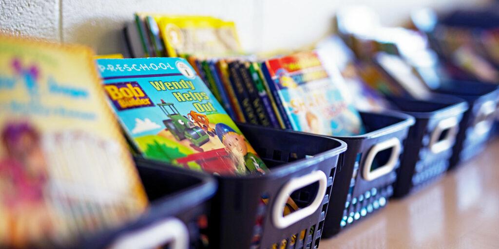 Book baskets on a classroom shelf.