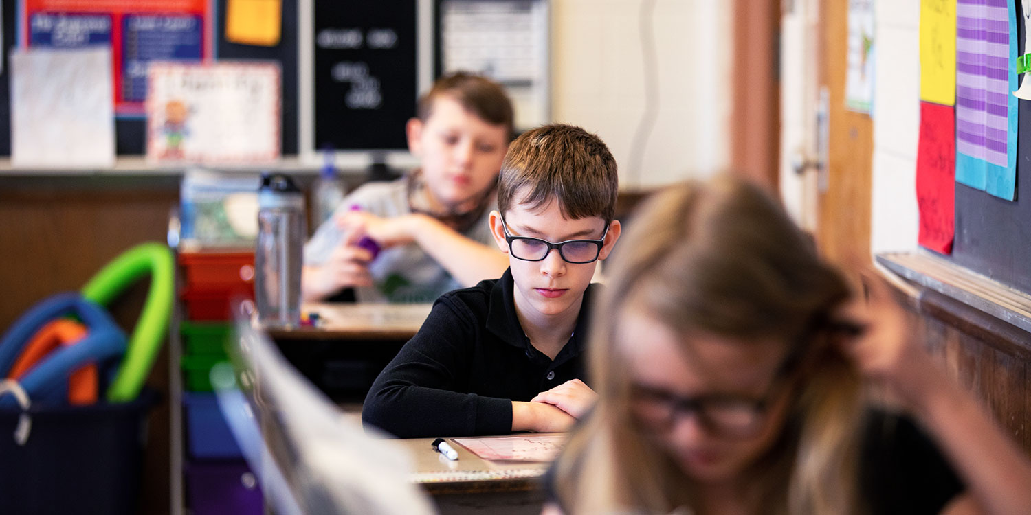 Students at desks in a classroom.