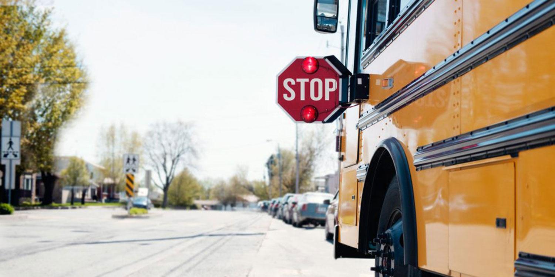 School bus stopped in a neighborhood.